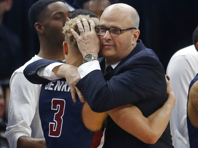 Fairleigh Dickinson coach Greg Herenda hugs Jahlil Jenkins (3) as he leaves the court during the second half against Gonzaga in a first-round game in the NCAA men's college basketball tournament Thursday, March 21, 2019, in Salt Lake City. (AP Photo/Rick Bowmer)