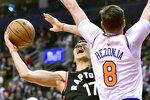 New York Knicks forward Mario Hezonja (8) fouls Toronto Raptors guard Jeremy Lin (17) on his way to the hoop during first half NBA basketball action in Toronto, Monday, March 18, 2019. (Frank Gunn/The Canadian Press via AP)