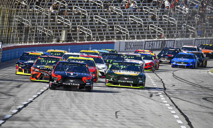 Clint Bowyer (14) and Kevin Harvick (4) battle for position during a NASCAR auto race at Texas Motor Speedway, Sunday, Nov. 3, 2019, in Fort Worth, Texas. Harvick would win the race. (AP Photo/Larry Papke)