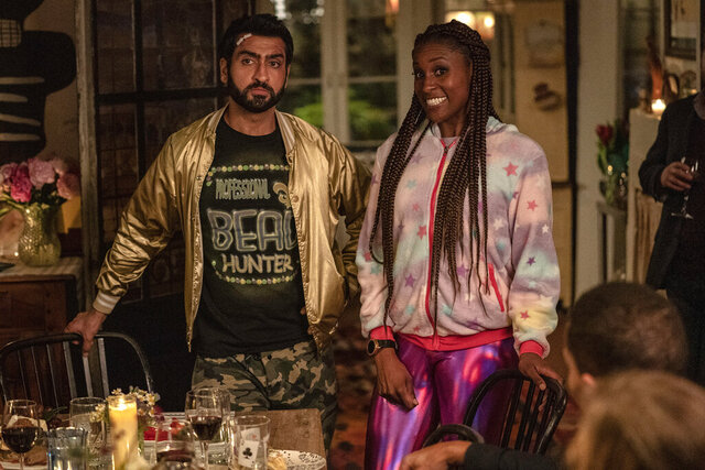 This image released by Netflix shows Issa Rae as Leilani, right, and Kumail Nanjiana as Jibran in a scene from