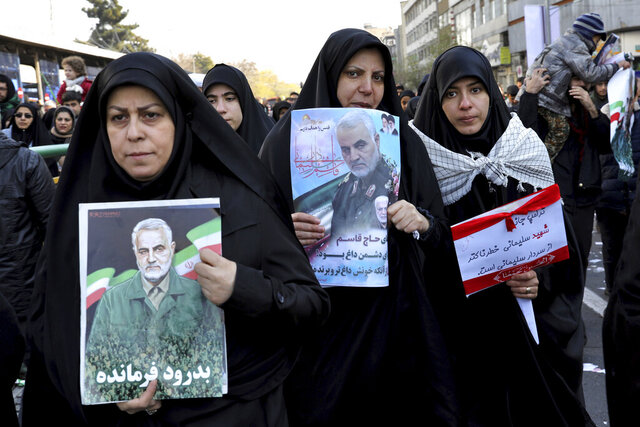 Mourners holding posters of Iranian Gen. Qassem Soleimani attend a funeral ceremony for him and his comrades, who were killed in Iraq in a U.S. drone strike on Friday, at the Enqelab-e-Eslami (Islamic Revolution) Square in Tehran, Iran, Monday, Jan. 6, 2020. The processions mark the first time Iran honored a single man with a multi-city ceremony. Not even Ayatollah Ruhollah Khomeini, who founded the Islamic Republic, received such a processional with his death in 1989. Soleimani on Monday will lie in state at Tehran's famed Musalla mosque as the revolutionary leader did before him. (AP Photo/Ebrahim Noroozi)