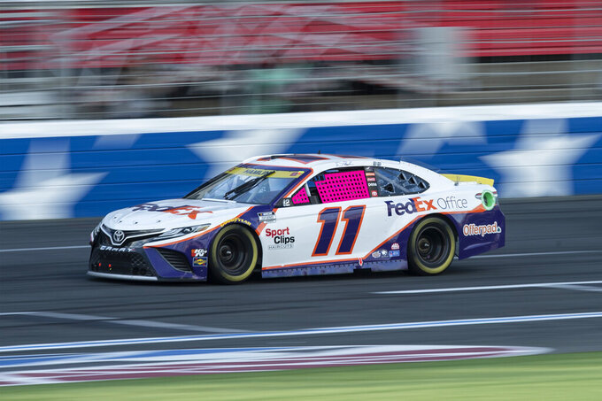 Denny Hamlin (11) competes during a NASCAR Cup Series auto racing race at Charlotte Motor Speedway, Sunday, Oct. 10, 2021, in Concord, N.C. (AP Photo/Matt Kelley)