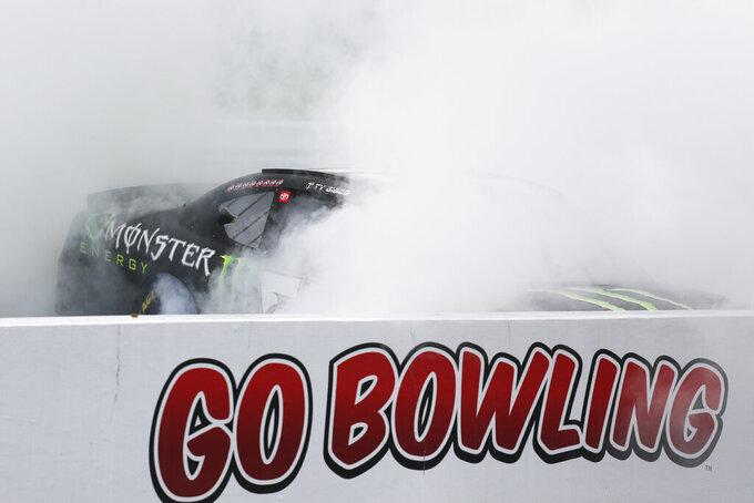 NASCAR Xfinity Series driver Ty Gibbs does a burnout after winning the NASCAR Xfinity Series auto race at Watkins Glen International in Watkins Glen, N.Y., on Saturday, Aug. 7, 2021. (AP Photo/Joshua Bessex)