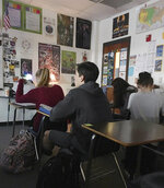 In this photo provided by ninth grader Kirsten Martin, students at Carlton J. Kell High School in Cobb County, Ga., sit in their classroom after they were asked not to leave by staff, Wednesday, March 14, 2018. Young people across the U.S. walked out of school to demand action on gun violence Wednesday in what activists hoped would be the biggest demonstration of student activism yet in response to the previous month's massacre in Florida. However students at most Cobb County schools were not permitted to leave classrooms. (Kirsten Martin via AP)