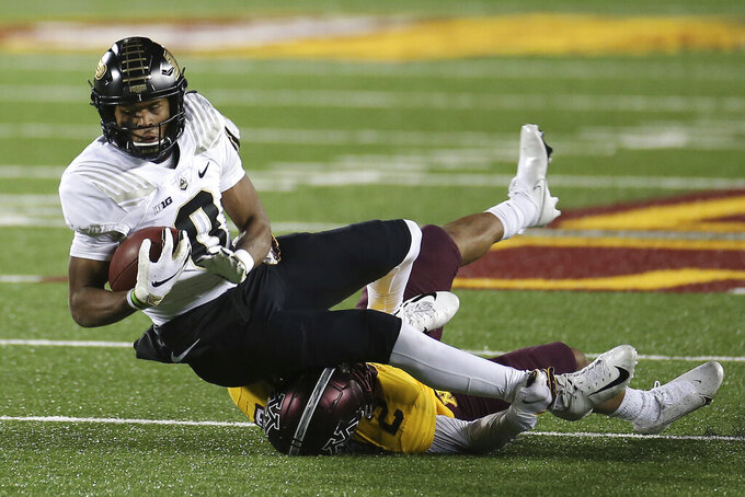 Purdue wide receiver Milton Wright (0) is tackled by Minnesota defensive back Phillip Howard (2) during the second half of an NCAA college football game Friday, Nov. 20, 2020, in Minneapolis. Minnesota won 34-31. (AP Photo/Stacy Bengs)