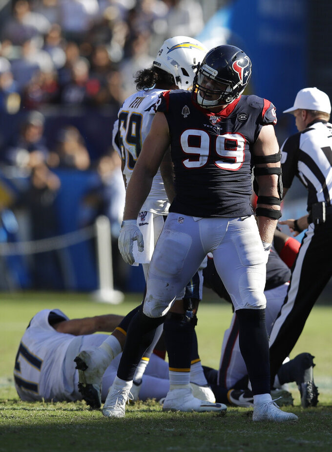 Houston Texans defensive end J.J. Watt celebrates after sacking Los Angeles Chargers quarterback Philip Rivers during the second half of an NFL football game Sunday, Sept. 22, 2019, in Carson, Calif. (AP Photo/Marcio Jose Sanchez)