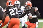 Cleveland Browns quarterback Baker Mayfield (6) hands the ball off to running back Kareem Hunt (27) during the first half of an NFL football game against the Las Vegas Raiders, Sunday, Nov. 1, 2020, in Cleveland. (AP Photo/David Richard)