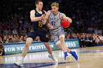 Duke forward Jack White (41) drives around California forward Grant Anticevich (15) during the first half of the first round of the 2K Empire Classic NCAA college basketball tournament, Thursday, Nov. 21, 2019, in New York. (AP Photo/Kathy Willens)
