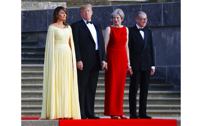 From left, first lady Melania Trump, President Donald Trump, British Prime Minister Theresa May and her husband Philip May watch the arrival ceremony at Blenheim Palace, Oxfordshire, Thursday, July 12, 2018. (AP Photo/Pablo Martinez Monsivais)