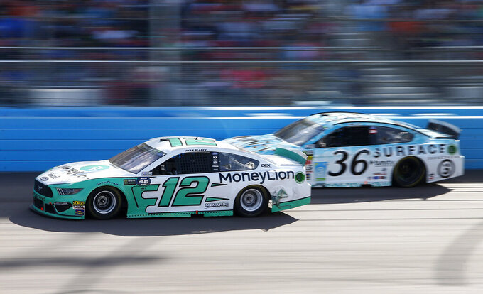 Ryan Blaney (12) and Matt Tifft (36) race through Turn 4 during the NASCAR Cup Series auto race at ISM Raceway, Sunday, March 10, 2019, in Avondale, Ariz. (AP Photo/Ralph Freso)