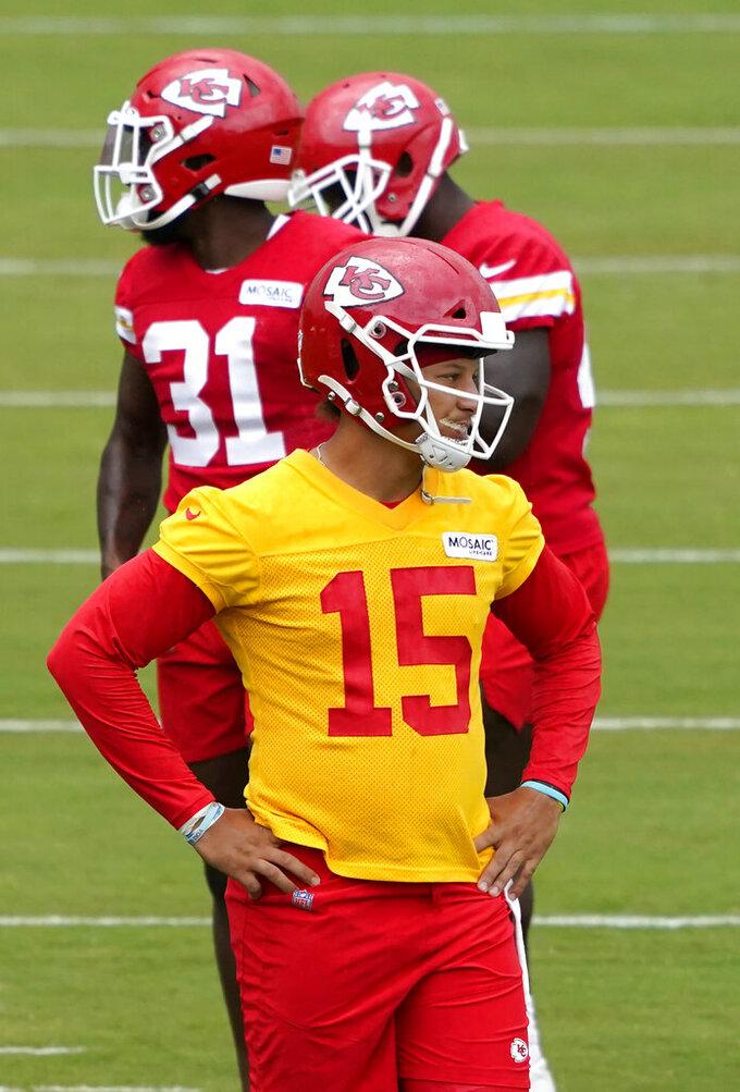 Kansas City Chiefs quarterback Patrick Mahomes (15) waits to run drills during the team's NFL football training camp Saturday, July 31, 2021, in St. Joseph, Mo. (AP Photo/Ed Zurga)