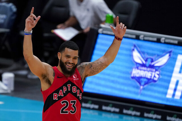 Toronto Raptors guard Fred VanVleet celebrates after scoringing against the Charlotte Hornets during the first half of an NBA preseason basketball game in Charlotte, Monday, Dec. 14, 2020. (AP Photo/Chris Carlson)