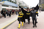 Jay Acey of New York City, left, dressed as DC Comics character