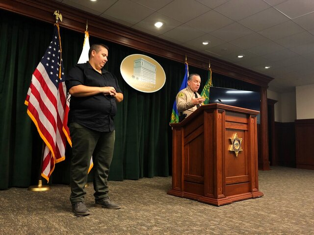 Los Angeles County Sheriff Alex Villanueva, right, announces the rollout of body-worn cameras for deputies during a news conference in Los Angeles on Wednesday, Aug. 12, 2020. Villanueva said 1,200 deputies in five patrol stations will receive the body cameras beginning Oct. 1.  (AP Photo/Stefanie Dazio)