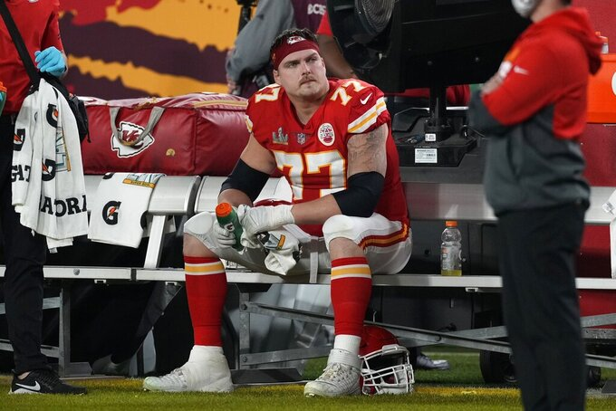 Kansas City Chiefs offensive guard Andrew Wylie sits on the bench during the second half of the NFL Super Bowl 55 football game against the Tampa Bay Buccaneers Sunday, Feb. 7, 2021, in Tampa, Fla. (AP Photo/Chris O'Meara)