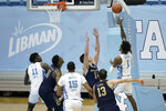 North Carolina guard Leaky Black (1) takes a shot to give his team the lead against Notre Dame late in the second half of an NCAA college basketball game in Chapel Hill, N.C., Saturday, Jan. 2, 2021. (AP Photo/Gerry Broome)