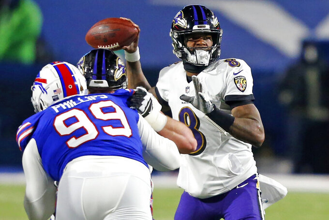 Baltimore Ravens quarterback Lamar Jackson (8) throws a pass during the first half of an NFL divisional round football game against the Buffalo Bills Saturday, Jan. 16, 2021, in Orchard Park, N.Y. (AP Photo/Jeffrey T. Barnes)