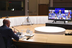 European Council President Charles Michel speaks with EU leaders, via videoconference link, during a EU summit at the European Council building in Brussels, Thursday, March 25, 2021. European Union leaders are looking for ways of ramping up COVID-19 vaccination across the region during their virtual meeting Thursday amid shortage of doses, spikes of new coronavirus cases, a feud with the United Kingdom and internal quarrels. (Yves Herman, Pool via AP)