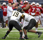 Appalachian State defensive back Mike Price (19) and outside linebacker Nick Hampton (31) tackle South Alabama running back Tra Minter (5) during the first half of an NCAA college football game Saturday, Oct. 26, 2019, at Ladd-Peebles Stadium in Mobile, Ala. (AP Photo/Julie Bennett)