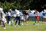 Golfers hit on the driving range during a practice round prior to the women's golf event at the 2020 Summer Olympics, Monday, Aug. 2, 2021, at the Kasumigaseki Country Club in Kawagoe, Japan. (AP Photo/Andy Wong)