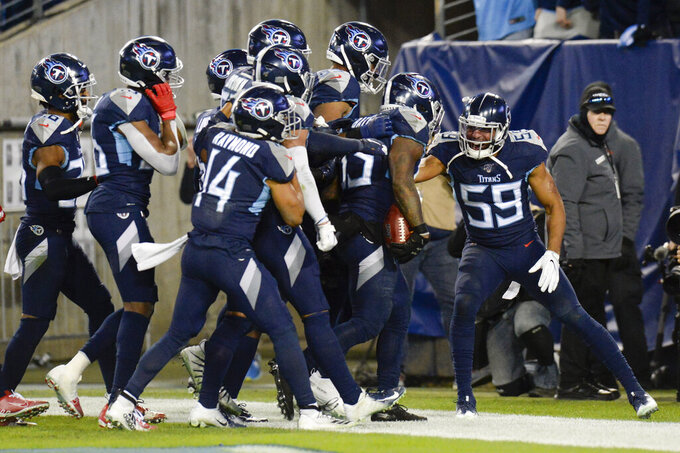 Tennessee Titans inside linebacker Wesley Woodyard (59) celebrates after linebacker Daren Bates (53) recovered a Jacksonville Jaguars' fumble in the second half of an NFL football game Sunday, Nov. 24, 2019, in Nashville, Tenn. (AP Photo/Mark Zaleski)