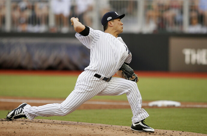 New York Yankees starting pitcher Masahiro Tanaka throws a pitch against the Boston Red Sox during the first inning of a baseball game, Saturday, June 29, 2019, in London. Major League Baseball made its European debut game today at London Stadium. (AP Photo/Tim Ireland)