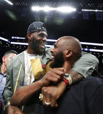 LeBron James embraces Chris Paul following an NBA basketball game between the Brooklyn Nets and the Miami Heat, Wednesday, April 10, 2019, in New York. The pair, along with Carmelo Anthony, were in New York to watch Dwyane Wade's final NBA game. (AP Photo/Kathy Willens)
