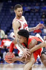 Georgia guard Sahvir Wheeler, bottom, is stopped by Mississippi forward KJ Buffen in the first half of an NCAA college basketball game in the Southeastern Conference Tournament Wednesday, March 11, 2020, in Nashville, Tenn. (AP Photo/Mark Humphrey)