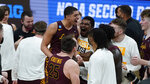 Loyola Chicago guard Lucas Williamson (1) celebrates after beating Illinois 71-58 after a men's college basketball game in the second round of the NCAA tournament at Bankers Life Fieldhouse in Indianapolis, Sunday, March 21, 2021. (AP Photo/Paul Sancya)