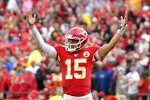 Kansas City Chiefs quarterback Patrick Mahomes (15) celebrates a touchdown by running back Darwin Thompson during the second half of an NFL football game against the Baltimore Ravens in Kansas City, Mo., Sunday, Sept. 22, 2019. (AP Photo/Ed Zurga)