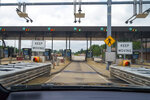 """In this photo made through a windshield, the sensors and lights are seen at the west bound toll gate of the Pennsylvania Turnpike in Cranberry Township, Pa., on Monday, Aug. 30, 2021. More than $104 million in Pennsylvania Turnpike tolls went uncollected last year as the agency fully converted to all-electronic tolling. Turnpike records show the millions of motorists who don't use E-ZPass have a nearly 1 in 2 chance of riding without paying under the """"toll-by-plate"""" license plate reader system.(AP Photo/Keith Srakocic)"""