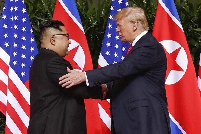 FILE - In this June 12, 2018, file photo, U.S. President Donald Trump, right, shakes hands with North Korea leader Kim Jong Un at the Capella resort on Sentosa Island in Singapore. South Korea said Friday, Jan. 10, 2020, it conveyed a message by President Donald Trump to North Korean leader Kim Jong Un wishing him a happy birthday, which is believed to be Jan. 8. (AP Photo/Evan Vucci, File)