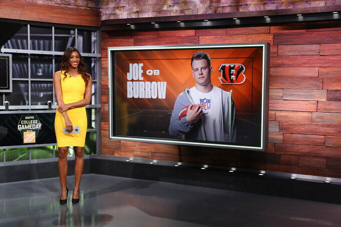 In a photo provided by ESPN Images, Maria Taylor of ESPN talks bout quarterback Joe Burrow, who was selected by the Cincinnati Bengals in the NFL football draft, Thursday, April 23, 2020, in Bristol, Conn. (Allen Kee/ESPN Images via AP)
