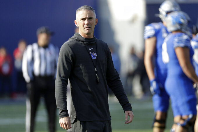 Memphis head coach Mike Norvell watches as players warm up before the start of an NCAA college football game against Cincinnati for the American Athletic Conference championship Saturday, Dec. 7, 2019, in Memphis, Tenn. (AP Photo/Mark Humphrey)