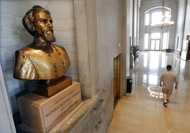"FILE - In this Aug. 17, 2017 file photo, a bust of Nathan Bedford Forrest is displayed in the Tennessee State Capitol in Nashville, Tenn. Tennessee lawmakers on Tuesday, Jan. 28, 2020,  remained torn on whether to support a proposal the removal of a contentious bust of a former Confederate general and early leader of the Ku Klux Klan. If approved by the GOP-controlled Legislature, the measure encourages the bust of Nathan Bedford Forrest be removed from the Tennessee Capitol and instead be replaced with an ""appropriate tribute to a deserving Tennessean."" (AP Photo/Mark Humphrey, File)"