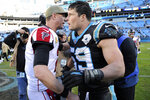 Atlanta Falcons quarterback Matt Ryan, left, and Carolina Panthers middle linebacker Luke Kuechly (59) speak following an NFL football game in Charlotte, N.C., Sunday, Nov. 17, 2019. (AP Photo/Mike McCarn)