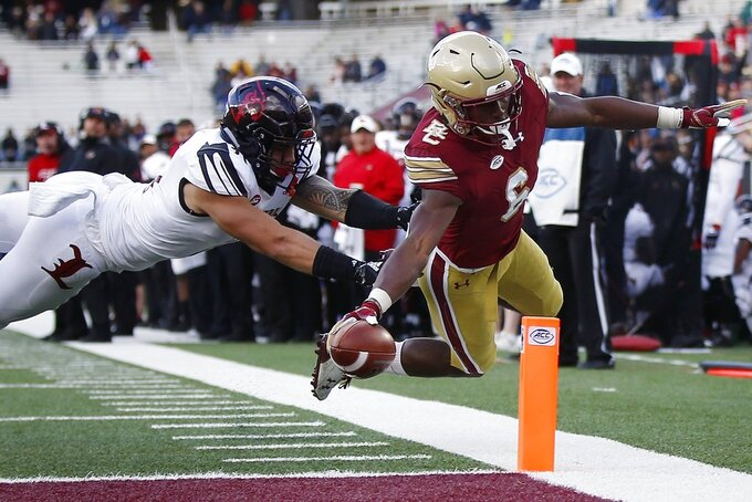 Boston College wide receiver Jeff Smith (6) reaches over the goal line to score a touchdown against Louisville safety London Iakopo during the second half of an NCAA college football game in Boston, Saturday, Oct. 13, 2018. (AP Photo/Michael Dwyer)