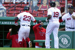 Boston Red Sox's Michael Chavis (23) and Jackie Bradley Jr. (19) are welcomed to the dugout after Chavis hit a two-run home run off a pitch by New York Yankees' Deivi Garcia in the second inning of a baseball game Sunday, Sept. 20, 2020, in Boston. (AP Photo/Steven Senne)