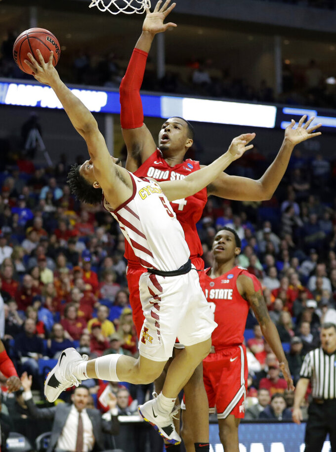 Iowa State's Lindell Wigginton, front, throws up a shot as Ohio State's Kaleb Wesson defends during the first half of a first round men's college basketball game in the NCAA Tournament Friday, March 22, 2019, in Tulsa, Okla. (AP Photo/Jeff Roberson)