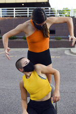 Madison Elliott and Madeleine Scott choreograph elements of the next Headlights Theater performance on Tuesday, July 28, in a parking lot in Sioux Falls, S.D. (Erin Bormett/The Argus Leader via AP)