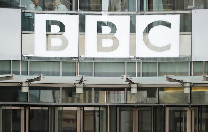 FILE - In this file photo dated Wednesday, July 19, 2017, The BBC sign outside the entrance to the headquarters of the publicly funded media organisation in London.  A BBC correspondent in China, John Sudworth, has relocated to Taiwan, saying Wednesday March 31, 2021, he faced threats and intimidation from authorities in Beijing. (AP Photo/Frank Augstein, FILE)