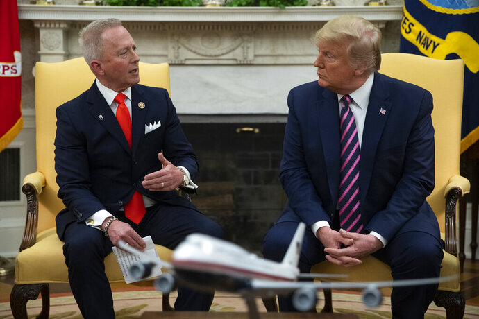 FILE - In this Dec. 19, 2019 photo, President Donald Trump, right, meets with Rep. Jeff Van Drew in the Oval Office of the White House in Washington. Trump is coming next week to the Jersey shore to reward newly minted Republican Rep. Jeff Van Drew for leaving the Democrats and opposing impeachment and is expected to attract a crowd and headlines. But Van Drew has also been crisscrossing the district to secure support from local GOP  that he spent years fighting. (AP Photo/ Evan Vucci, File)