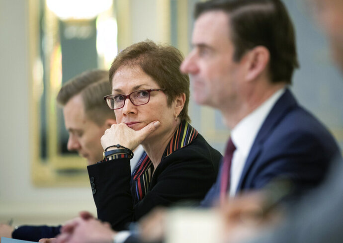 FILE - In this March 6, 2019 file photo, then U.S. Ambassador to Ukraine Marie Yovanovitch, center, sits during her meeting with Ukrainian President Petro Poroshenko in Kiev, Ukraine.  (Mikhail Palinchak, Presidential Press Service Pool Photo via AP)