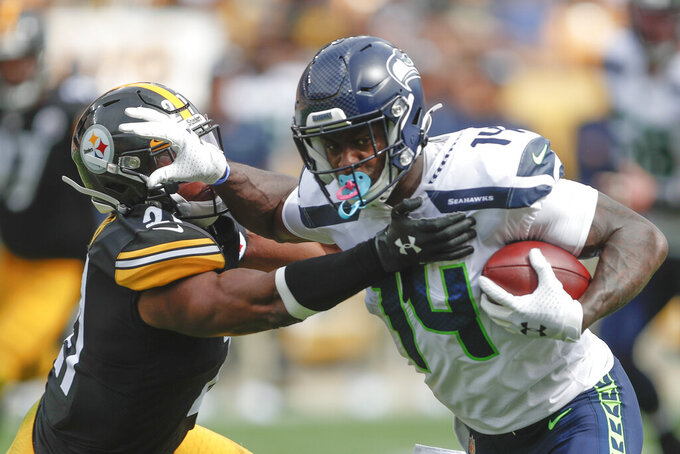Seattle Seahawks wide receiver John Ursua (15) stiff arms Pittsburgh Steelers free safety Sean Davis (21) after making a catch in the second half of an NFL football game, Sunday, Sept. 15, 2019, in Pittsburgh. (AP Photo/Don Wright)