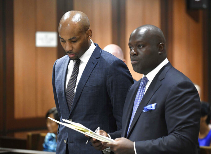 FILE - In this Aug. 9, 2018 file photo, Jamill Jones, left, appears in Queens Criminal Court in New York. The former Wake Forest University assistant basketball coach has been found guilty on Friday, Feb. 7, 2020 by a jury of misdemeanor assault for the punch that killed 35-year-old Sandor Szabo in August 2018. (Barry Williams/Dailymail.com via AP, Pool, File)