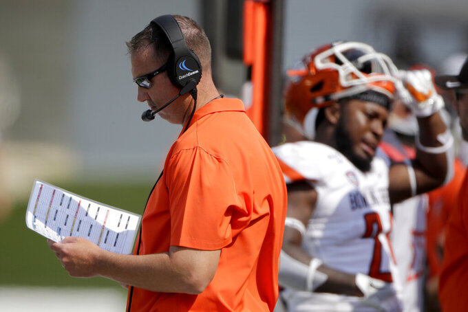 Bowling Green head coach Scot Loeffler looks over notes during the first half of an NCAA college football game against the Kansas State Saturday, Sept. 7, 2019, in Manhattan, Kan. (AP Photo/Charlie Riedel)
