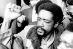 """FILE - In this May 28, 1971 file photo, Bobby Seale, co-founder of the Black Panther Party, gestures after being freed after serving 21 months in prison in New Haven, Conn. Today's protests across America against racial injustice are being watched closely by people who five decades ago faced jail cells, bloody assaults, snarling dogs and even potential assassination in the battle against institutional racism. Seale said he finds the demonstrations """"fantastic"""" for drawing hundreds of thousands of people, far greater numbers that he could muster back in his day.  (AP Photo, File)"""