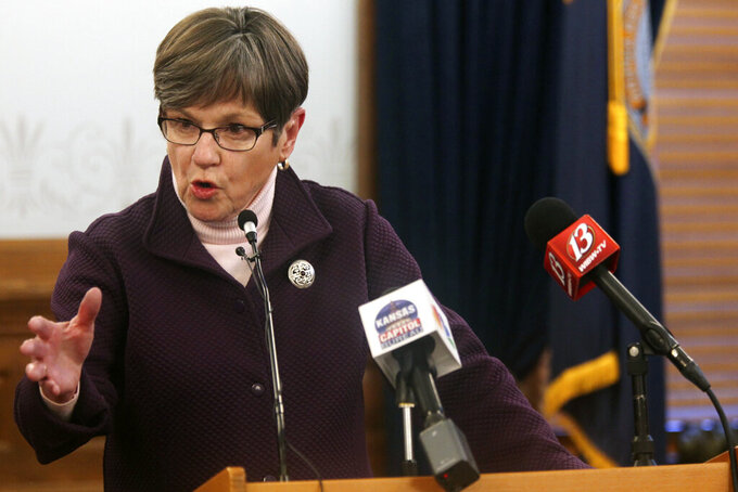 Kansas Gov. Laura Kelly answers questions during a news conference, Wednesday, Feb. 3, 2021, at the Statehouse in Topeka, Kan. The Democratic governor is facing increasingly vocal criticism from the Republican-controlled Legislature over problems at the state Department of Labor, that include a flood of fraudulent claims for unemployment benefits. (AP Photo/John Hanna)