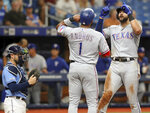 Texas Rangers' Joey Gallo, right, celebrates his home run with Elvis Andrus as Tampa Bay Rays' Travis d'Arnaud, left, looks on during the fourth inning of a baseball game Sunday, June 30, 2019, in St. Petersburg, Fla. (AP Photo/Mike Carlson)