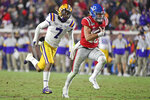 Mississippi quarterback John Rhys Plumlee (10) carries the ball past LSU safety Grant Delpit (7) during the second half of an NCAA college football game in Oxford, Miss., Saturday, Nov. 16, 2019. LSU won 58-37. (AP Photo/Thomas Graning)